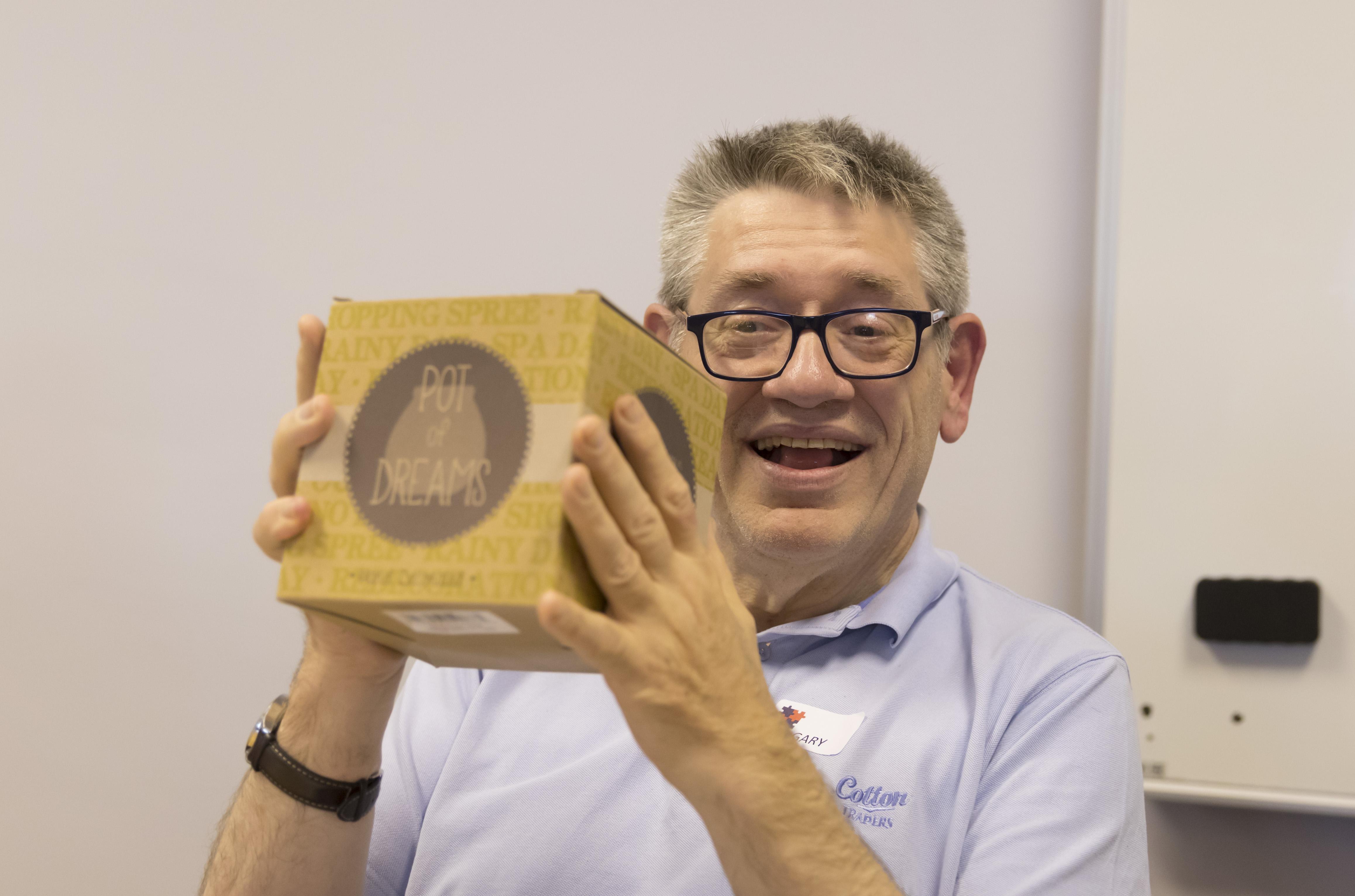 Gary winning a raffle prize